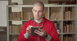 Closeup portrait of young attractive caucasian male student texting on the Footage