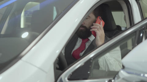 Portrait attractive confident bearded businessman sitting in the vehicle and Footage