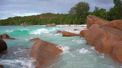 Seychelles. Praslin Island. Waves roll on the big stones. Tropical island luxury Footage