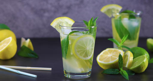 Homemade refreshing summer lemonade with mint in a glass Footage