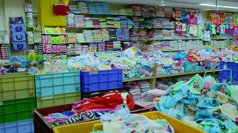 Interior of kids store. Racks with kids clothes in children's clothing store Footage
