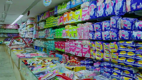 Shelf of baby consumer goods, products, diapers, napkin at Tops market Live Action