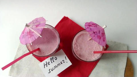 Two glasses fruit smoothies milkshake assembly Stock Video Footage