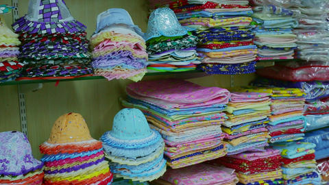 Kids cap, Kids clothing and toy store. Modern clothes for babies and children on display in children Footage