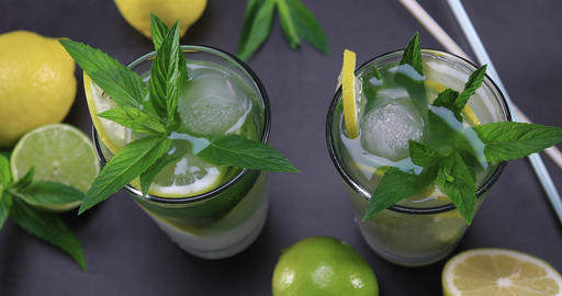 Top view of fresh lemonade with mint in glasses Footage