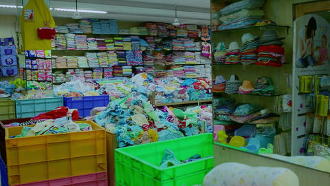Interior of kids store. Racks with kids clothes in children's clothing store. (Variety of cleaning & Live Action