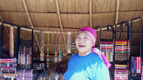 Mae Saiong. Thailand - 2019-03-11 - Woman With Black Teeth Tries To Sell Her Live Action