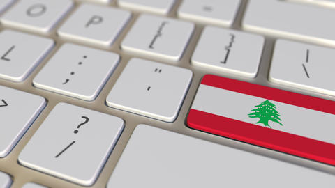 Key with flag of Lebanon on the keyboard switches to key with flag of Germany Footage