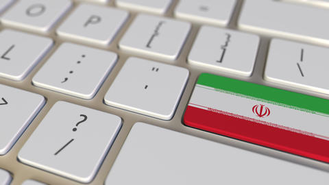 Key with flag of Iran on the keyboard switches to key with flag of Germany Footage