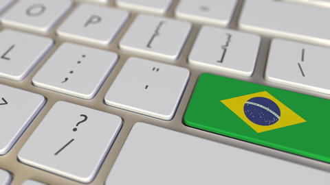 Key with flag of Brazil on the keyboard switches to key with flag of Germany Footage