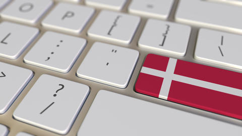 Key with flag of Denmark on the keyboard switches to key with flag of Germany Footage