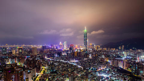 Time Lapse - Skyline of Taipei, Taiwan with Taipei 101 and Cloudscape at Night - 4K Live Action