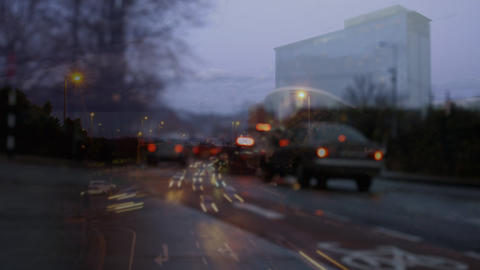 Cars driving on road with a digital animation of traffic on the foreground Animation