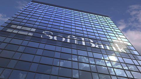 Logo of SOFTBANK on a media facade with reflecting cloudy sky, editorial Footage