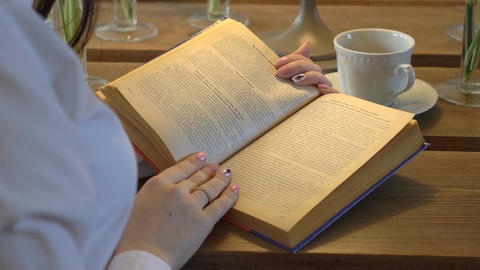 Woman Reads A Book And Drink Tea Extreme Close Up Footage