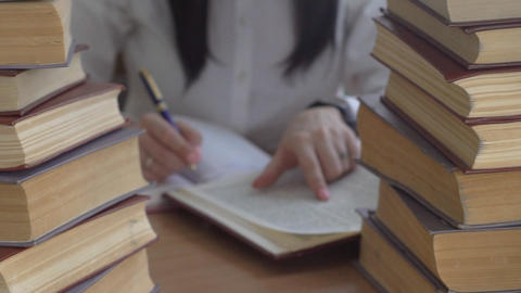 Young Woman Doing Homework In Library Footage