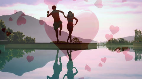 Cute couple jumping in a lake with digital hearts on the background Animation