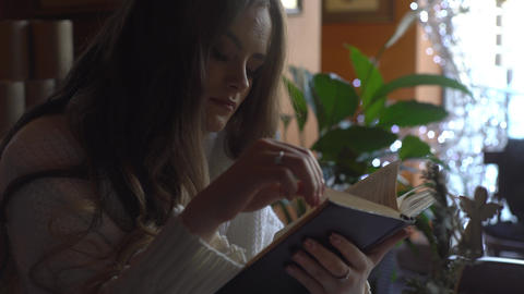 4K Girl Relaxing In The Cafe While Reading Interesting Book Live Action