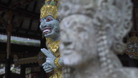 Indonesia god statue in front Bali temple, Indonesia. Traditional indonesian Live Action