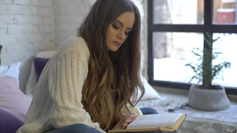 4K Girl Reading Book On The Bed Footage