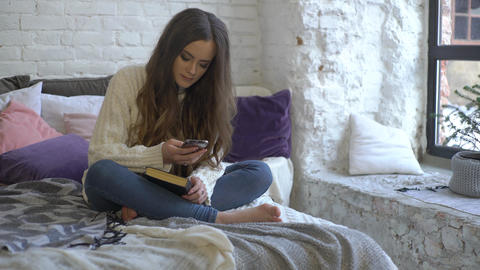 4K Girl Reading Book On The Bed Stock Video Footage