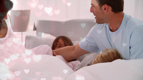 Digital composite of Happy family playing on bed Animation