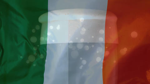 Irish flag with glass of beer and light effect on the background for St Patricks Day Animation