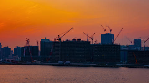 A time lapse of moving cranes at the bay area in Tokyo at dusk wide shot Footage