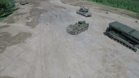 Flying over military vehicles on shooting ground Live Action