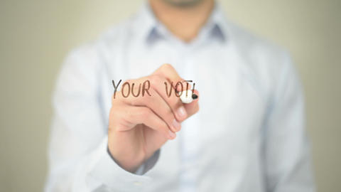 Your Vote is your Voice, man writing on transparent screen Footage