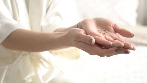Bride In Dressing Gown Holds In Her Hand Wedding Ring Live Action