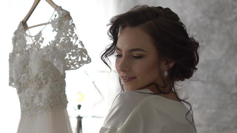 Beautiful Girl Looks And Admires Her Wedding Dress Getting Ready For The Wedding Footage