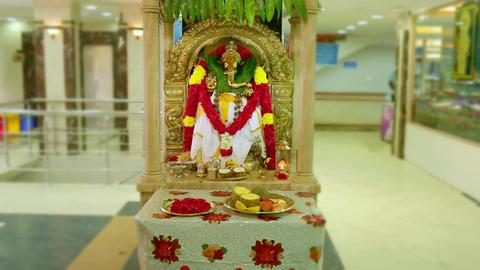Close up shot of a Hindu God Ganesha statue, Entrance To Saravana Stores Shopping Mall. Dolly Live Action