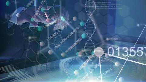 Businessman using digital touchscreen showing digital DNA molecule Live Action