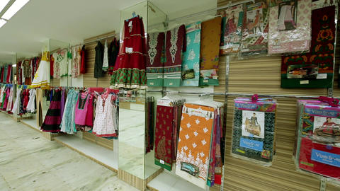 Shop of women's clothing. Women's panties on hangers in a store Footage