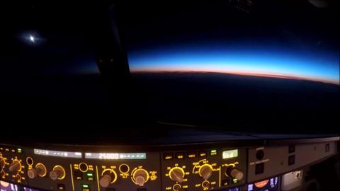 Airplane flies towards horizon at night Footage