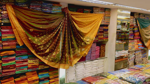Shop of women's clothing. Sari Shop. Indian Traditional Women's Sari clothing on Market. Buying Footage