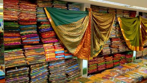 Shop of women's clothing. Sari Shop. Buying Wedding Sari in India. Lot of Colorful Beautiful Sari Footage