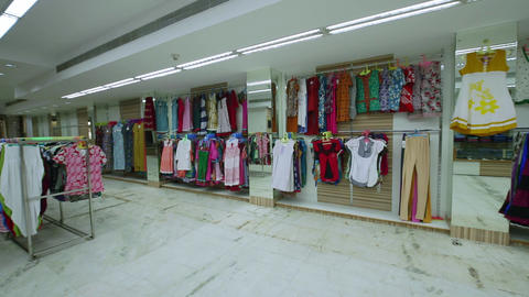 Interior of fashionable women's clothes store with clothes racks Live Action