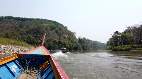Chiang Rae, Thailand - 2019-03-13 - Long Boat on River - Chasing Another Long Live Action