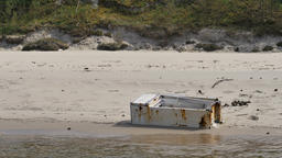 Abandoned, old fridge on a sea coast. Pollution of nature by the man Live Action