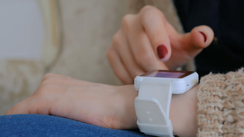 Woman using smart watch at home Footage