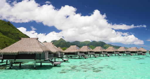Resort hotel in travel vacation paradise with overwater bungalow in ocean lagoon Footage