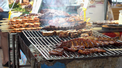 Fragrant meat grilling on city street Live Action