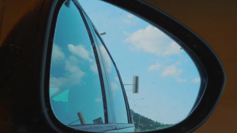 Right side rear view mirror at driving from light to tunnel Live Action