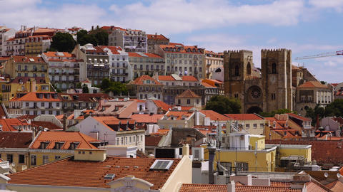Lisbon, Portugal panoramic view of Portuguese capital on a sunny day with puffy clouds against blue Live Action