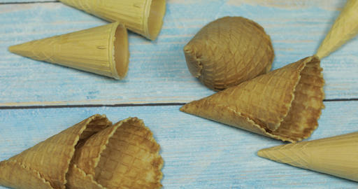 Ice cream cones, isolated on blue wooden surface. Waffles for ice cream Live Action