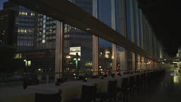 Empty Restaurant Tables with City View of Window at Dusk Live Action