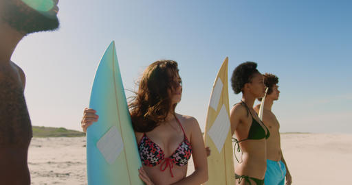 Group of happy friends standing with surfboard 4k Live Action