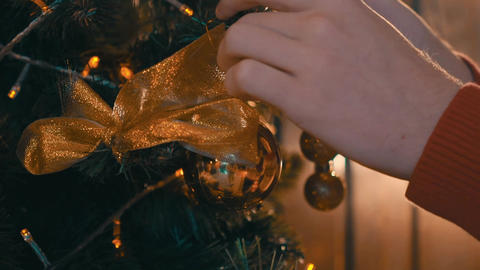 Close-Up Of A Pretty Young Girl Decorating A Decorative Christmas Tree Live Action